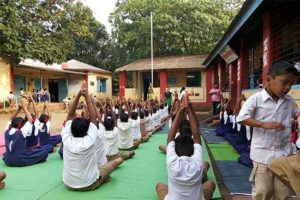 Students performing Indian yoga